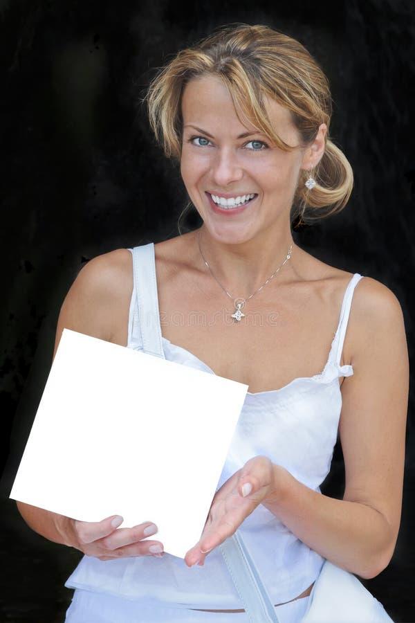 空白符号微笑的妇女 库存照片