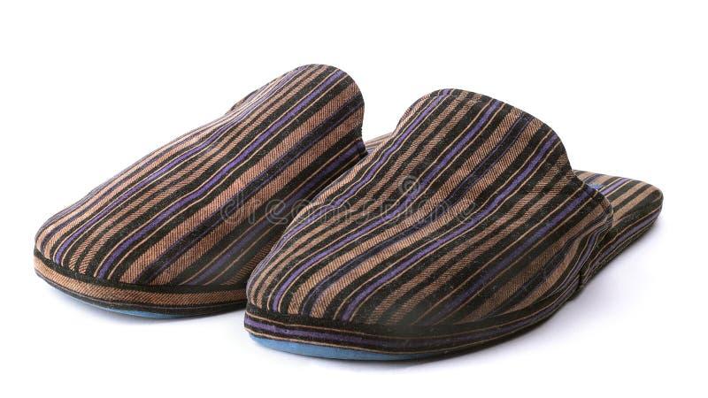 空白背景房子男性的拖鞋 免版税库存照片