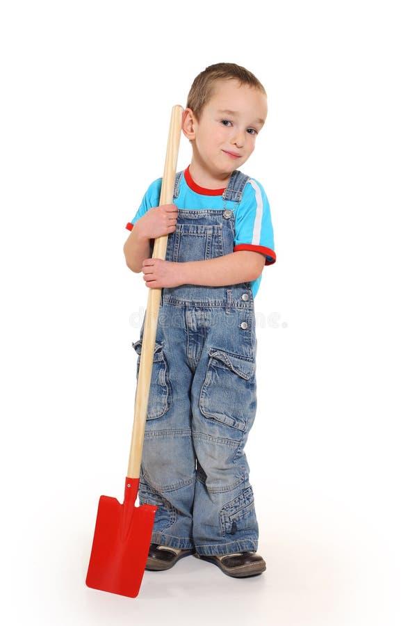 空白背景的男孩花匠 免版税库存图片