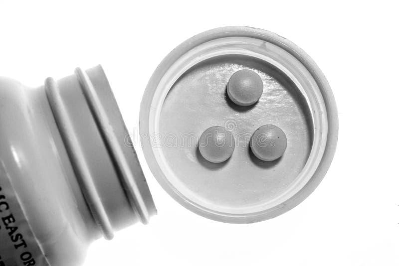 空白黑色的药片 库存图片