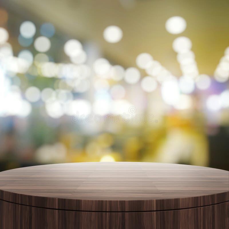 空的木圆桌和被弄脏的背景 免版税库存图片
