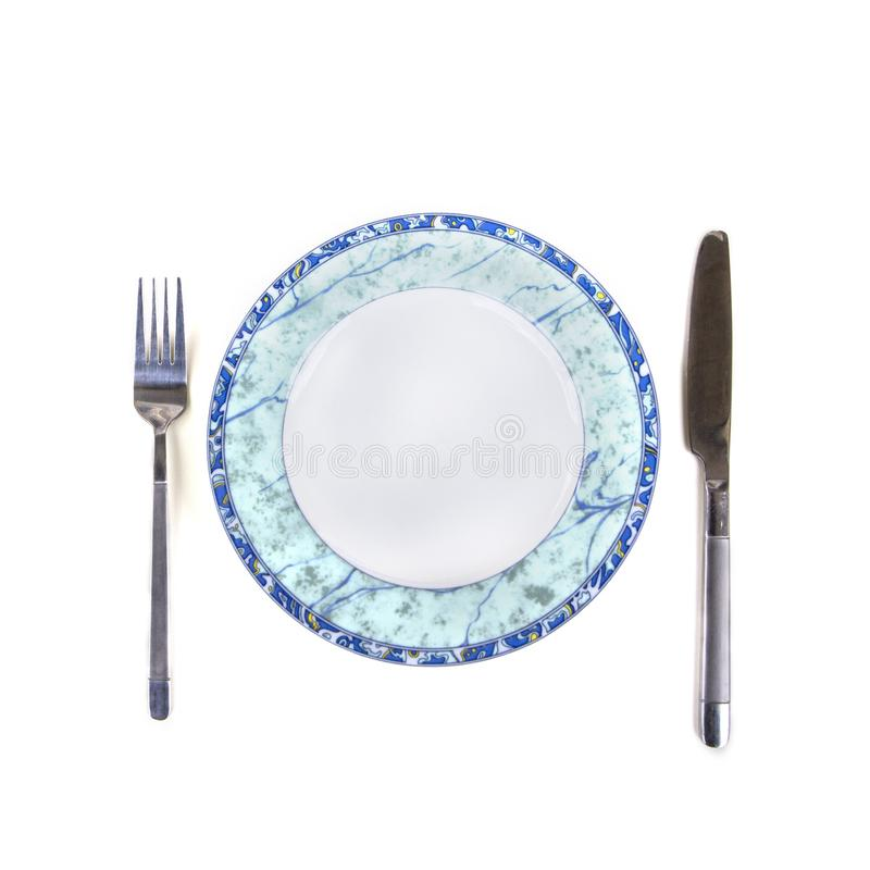 空的板材、叉子和刀子-被隔绝在白色背景 库存图片