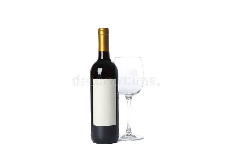 空的玻璃和瓶有在白色隔绝的红酒的 免版税库存照片