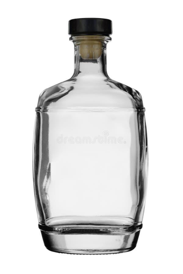 空的瓶由在白色背景的一个停止者密封了 免版税库存照片