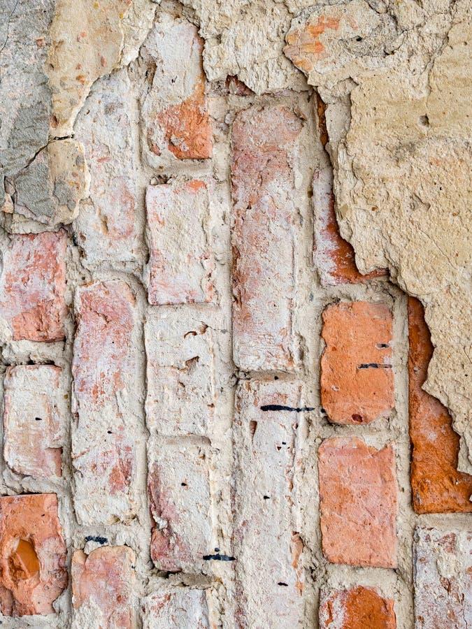 空的老砖墙纹理 被绘的困厄的墙壁表面 E r ?? 库存图片
