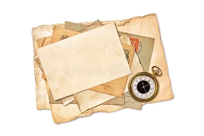 空的老葡萄酒大模型染黄了纸和怀表 免版税库存图片