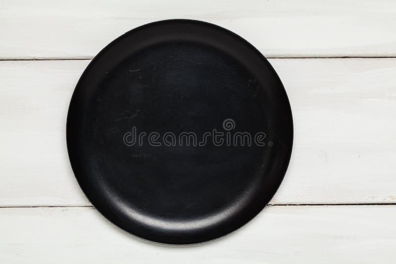 空的黑色的盘子顶视图 库存照片
