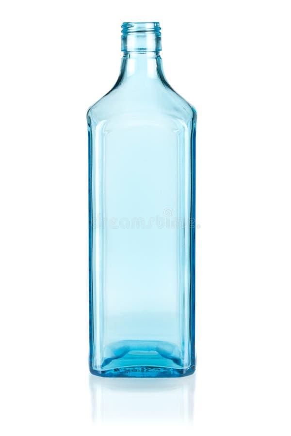 空蓝色的瓶 免版税库存照片