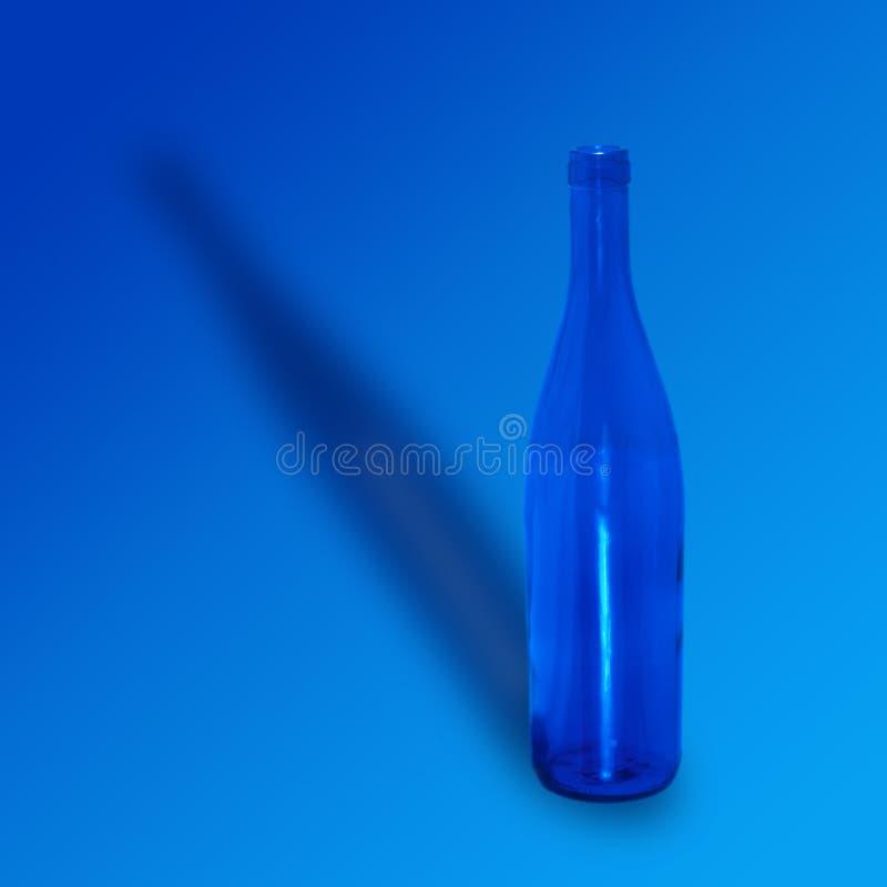 空蓝色的瓶 免版税库存图片