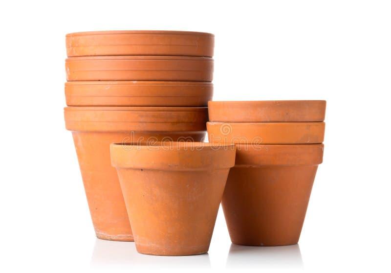 空,被堆积的,半新赤土陶器种植在丝毫的小组罐 免版税图库摄影