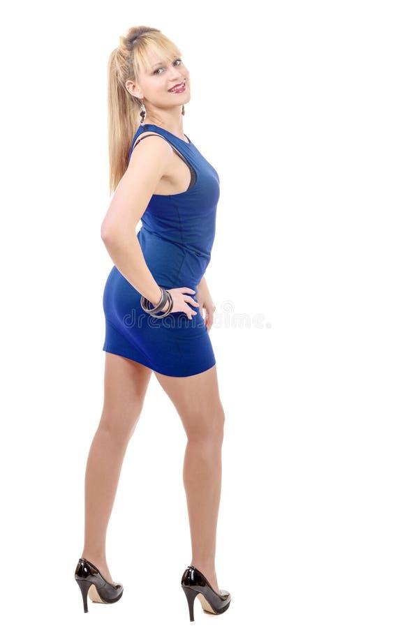 穿一件性感的蓝色礼服的少妇 库存照片