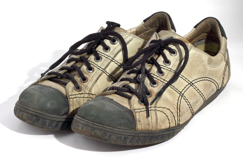 穿上鞋子被佩带的白色 免版税库存照片