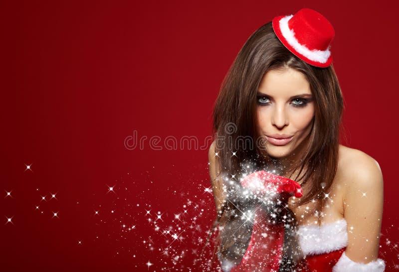 穿圣诞老人衣裳的女孩的画象 库存照片