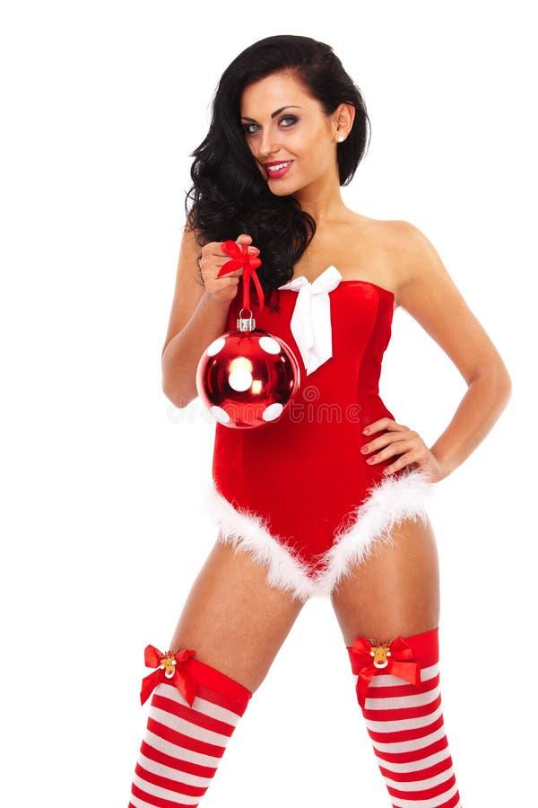 穿圣诞老人衣裳的美丽的性感的女孩 免版税库存照片