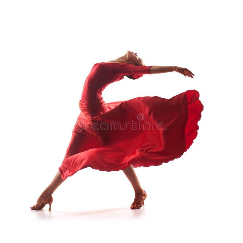 穿红色礼服的妇女舞蹈家 免版税库存图片