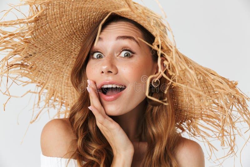 穿大草帽的激动的妇女20s画象特写镜头看 免版税库存照片