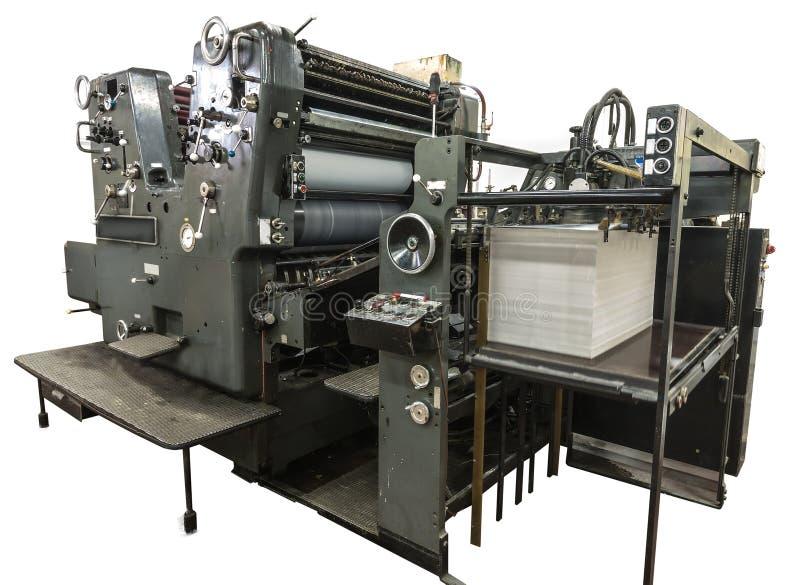 穿孔在老机器的机器和印刷品卡片 免版税库存照片