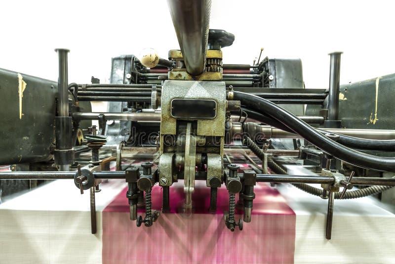 穿孔机器和印刷品卡片 图库摄影