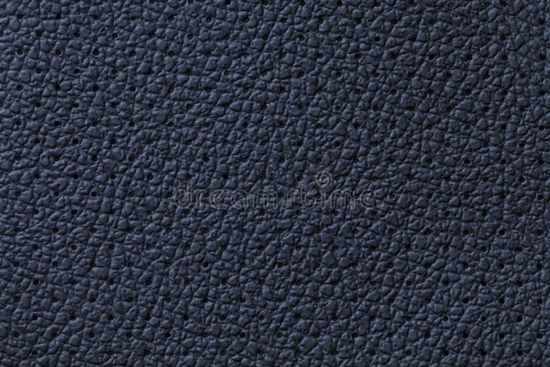 穿孔的水军蓝色皮革纹理背景,特写镜头 从皱痕皮肤的牛仔布背景 图库摄影