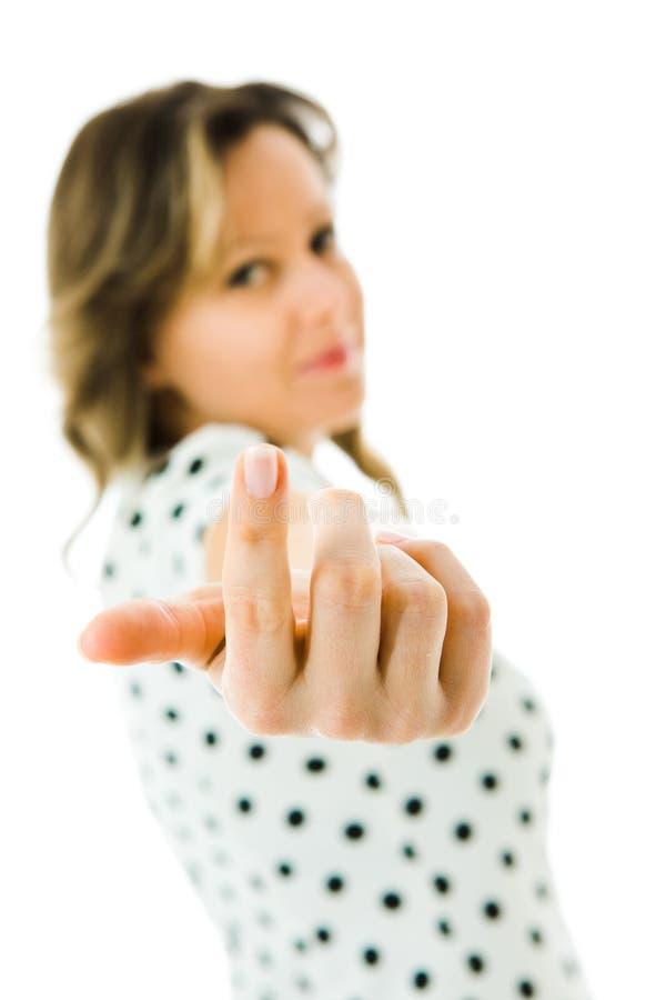 穿小点的礼服的可爱的妇女伸手支持 库存图片