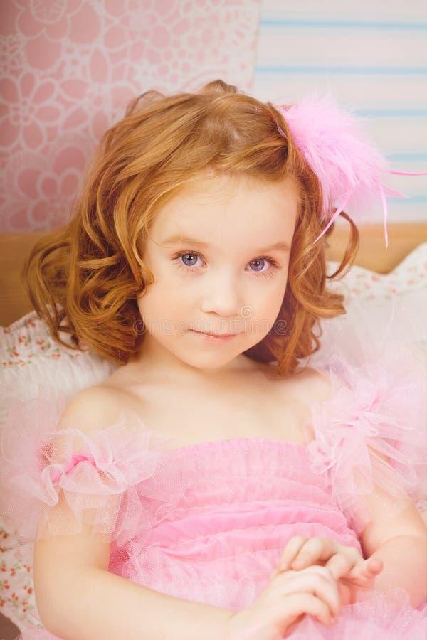 穿戴女孩苗圃粉红色 库存照片