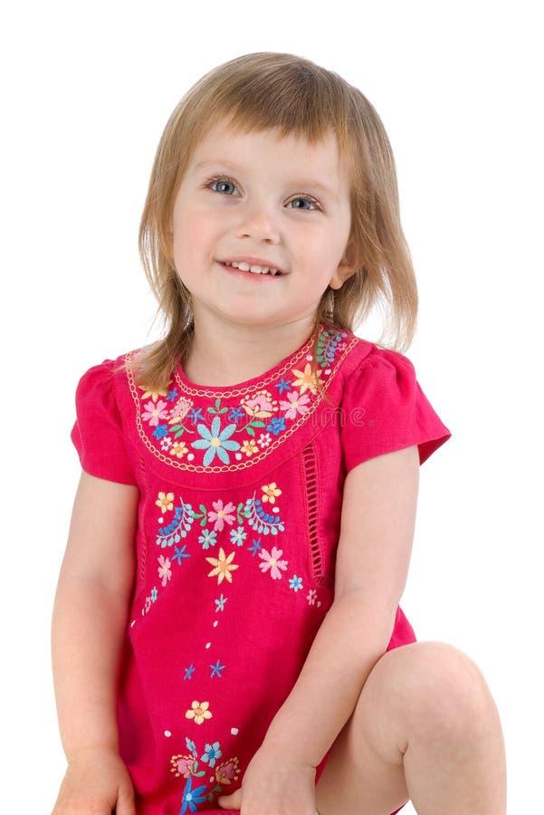 穿戴的女孩小的井 免版税库存照片