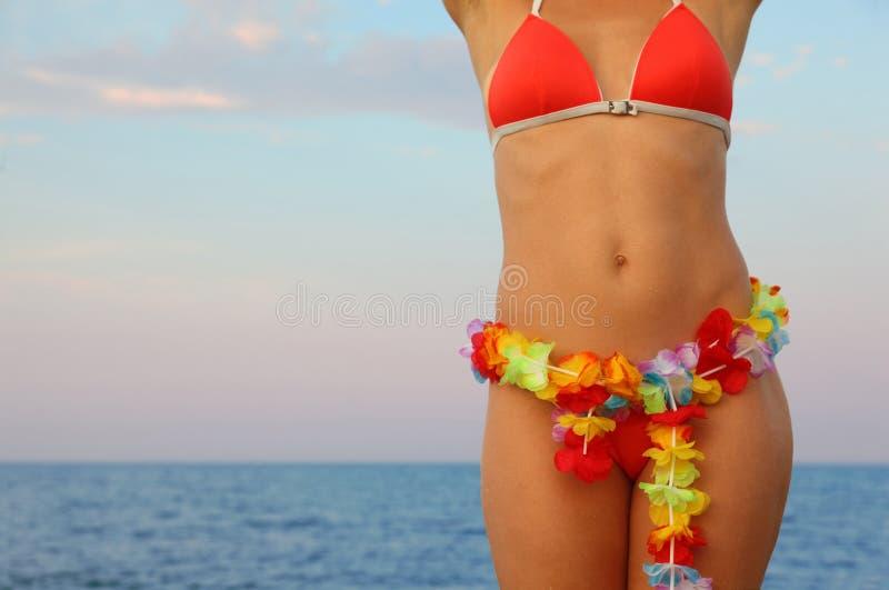 穿戴的海水浴场突出诉讼妇女 库存照片