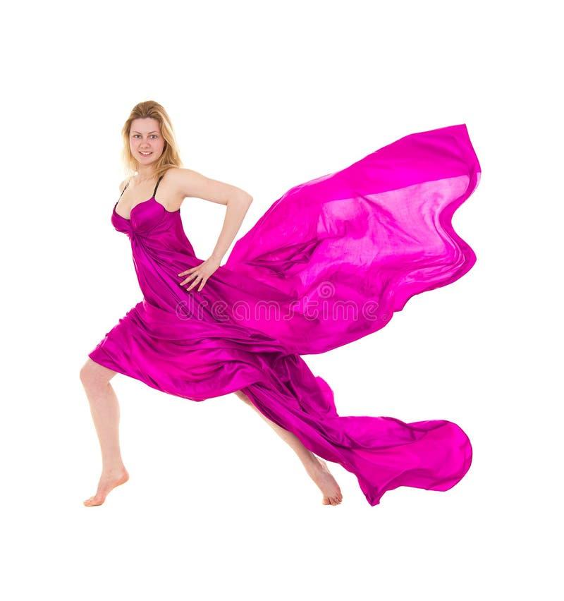 穿戴的飞行的桃红色组织妇女年轻人 免版税图库摄影