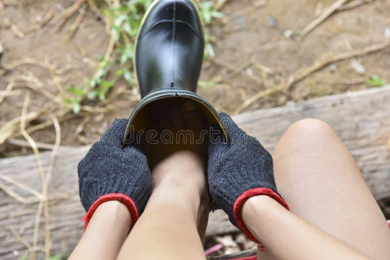 穿戴胶靴 免版税库存图片