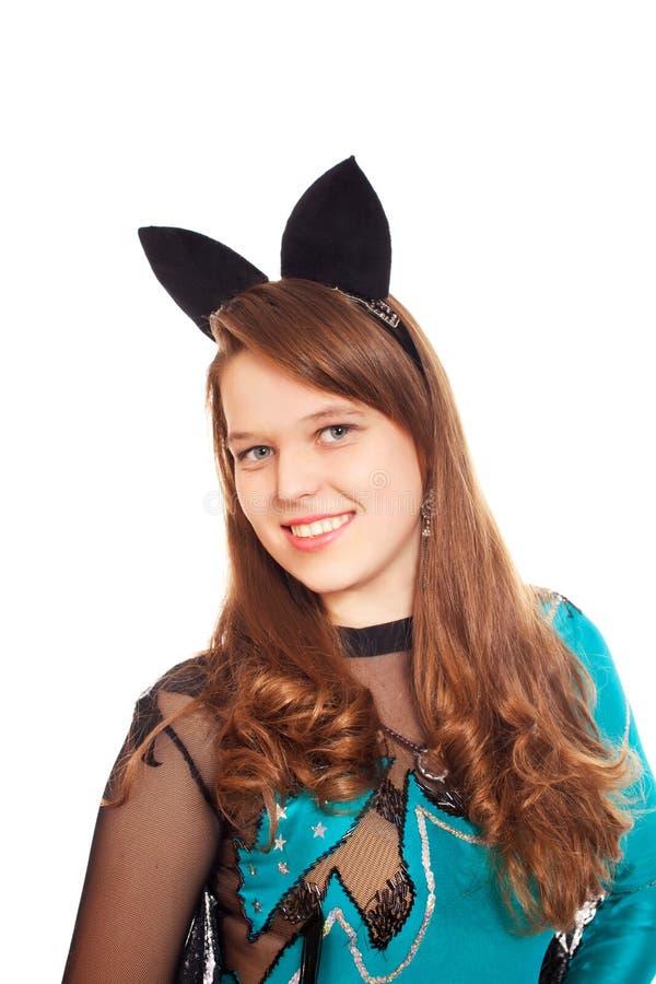 穿着万圣节棒服装的青少年的女孩 免版税库存图片