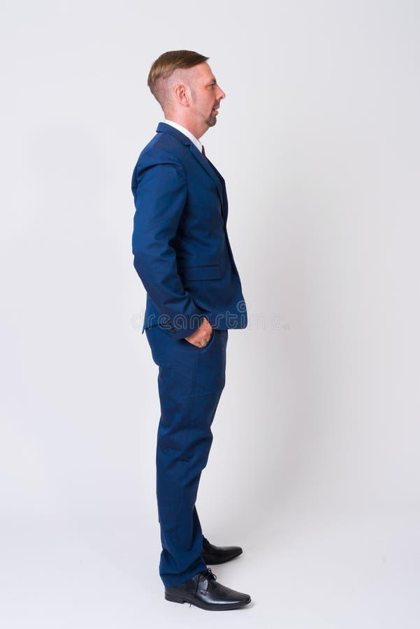 穿着蓝色衣服的白肤金发的商人充分的身体射击 库存照片
