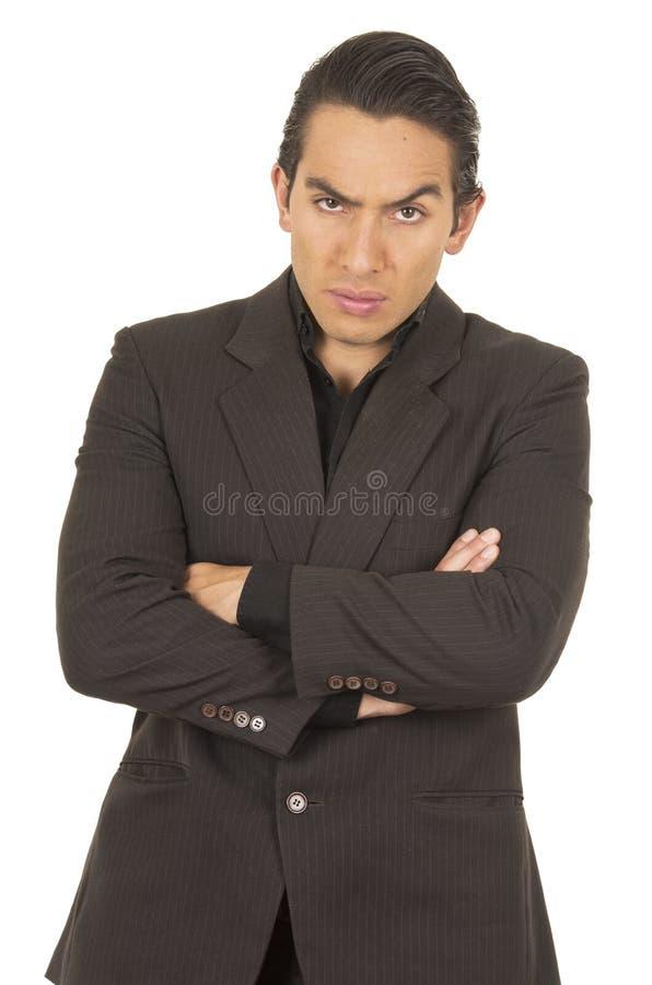 穿着衣服的英俊的年轻人摆在横穿 库存照片
