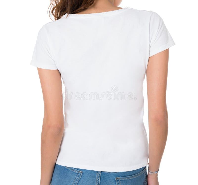 穿空白的白色T恤杉的少妇背面图 免版税库存图片