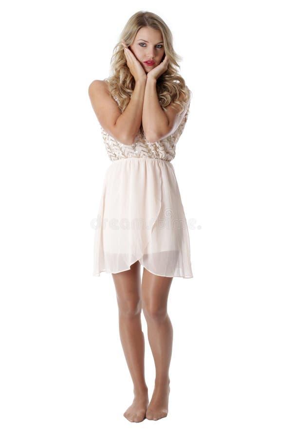 穿纯粹脆弱礼服的少妇 库存图片