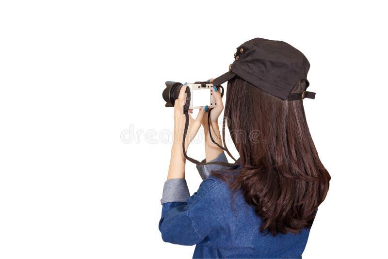 穿蓝色礼服的妇女旅客作为摄影师,采取照片wi 库存照片