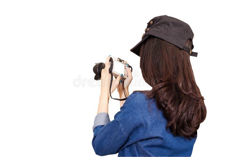 穿蓝色礼服的妇女旅客作为摄影师,采取照片wi 免版税库存照片