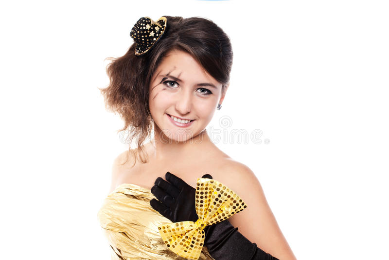 穿金黄礼服的青少年的女孩 免版税库存图片