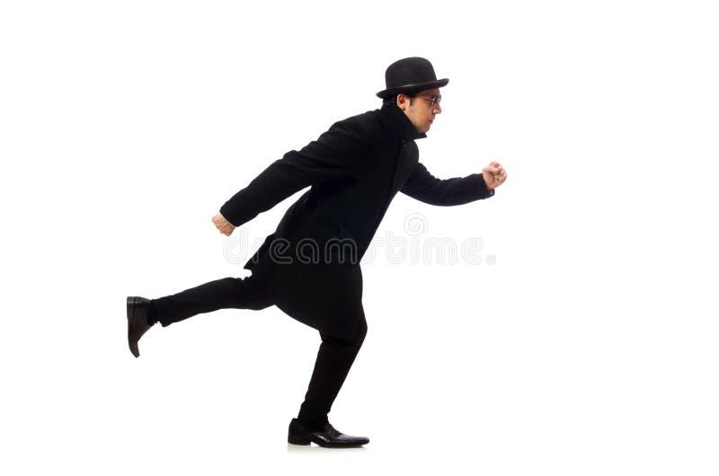 穿黑外套的人隔绝在白色 图库摄影