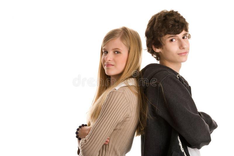突出回到的夫妇少年 免版税库存图片
