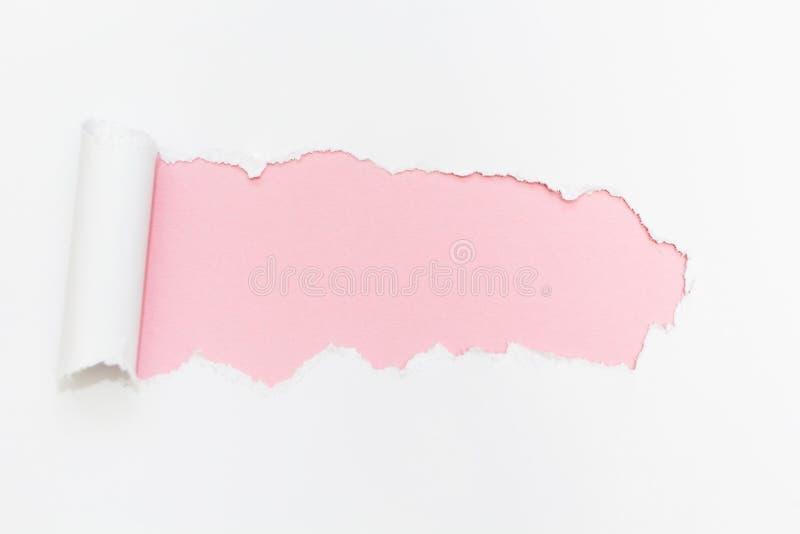 突破在被隔绝的白色背景的纸孔 免版税库存照片