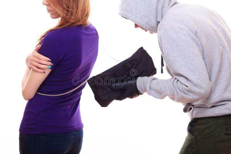 窃贼窃取妇女的钱包 库存图片