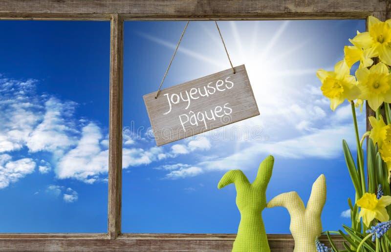 窗口,蓝天, Joyeuses Paques意味复活节快乐 库存图片