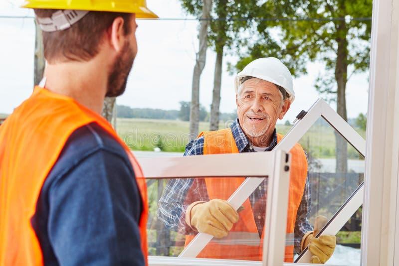 窗口建造者队工作 免版税库存图片