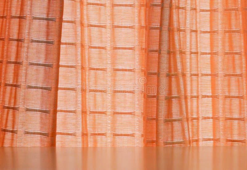 窗帘桔子 免版税库存照片