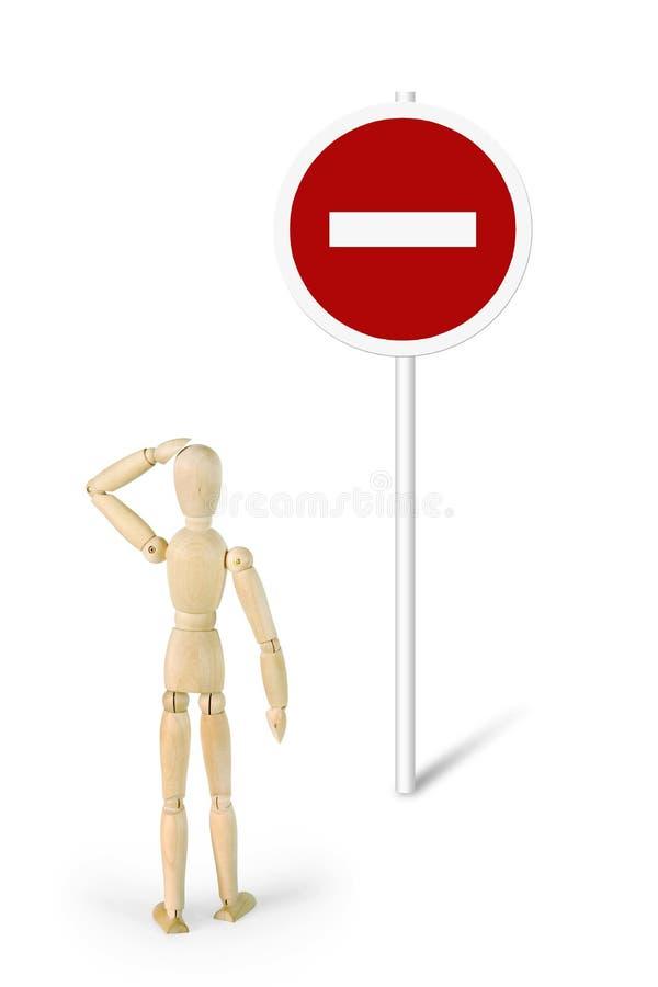 窘迫人在路标路前面站起来! 图库摄影