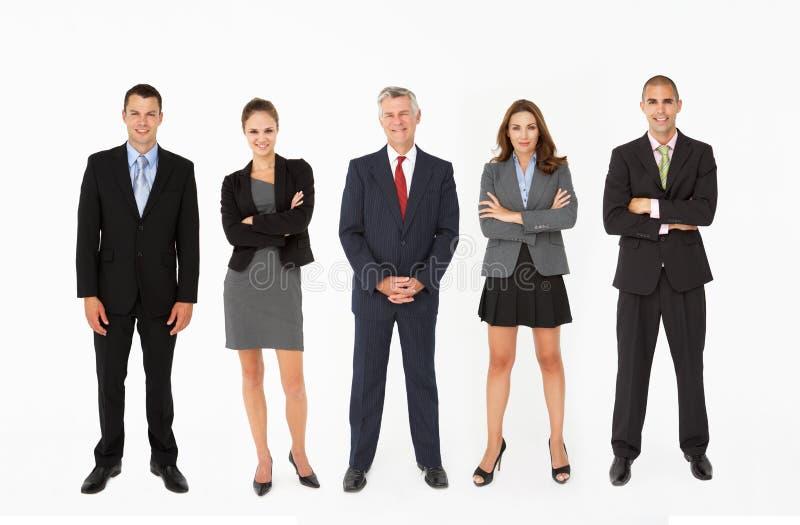 站在队中在工作室的组买卖人 免版税库存图片
