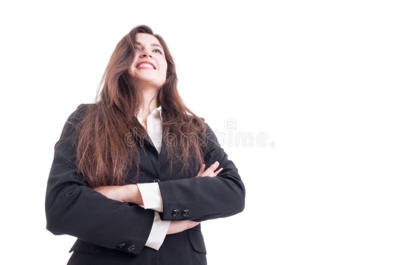站立与胳膊的微笑的女商人英雄射击横渡 免版税库存图片