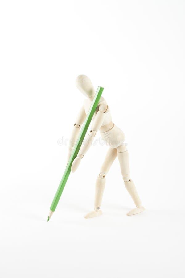 站立与颜色铅笔的木时装模特 图库摄影