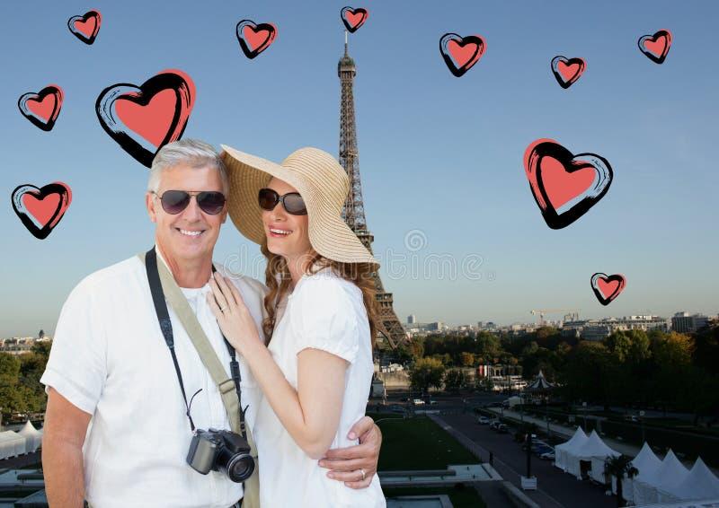 站立反对数位引起的埃佛尔铁塔和心脏的夫妇的综合图象 库存照片