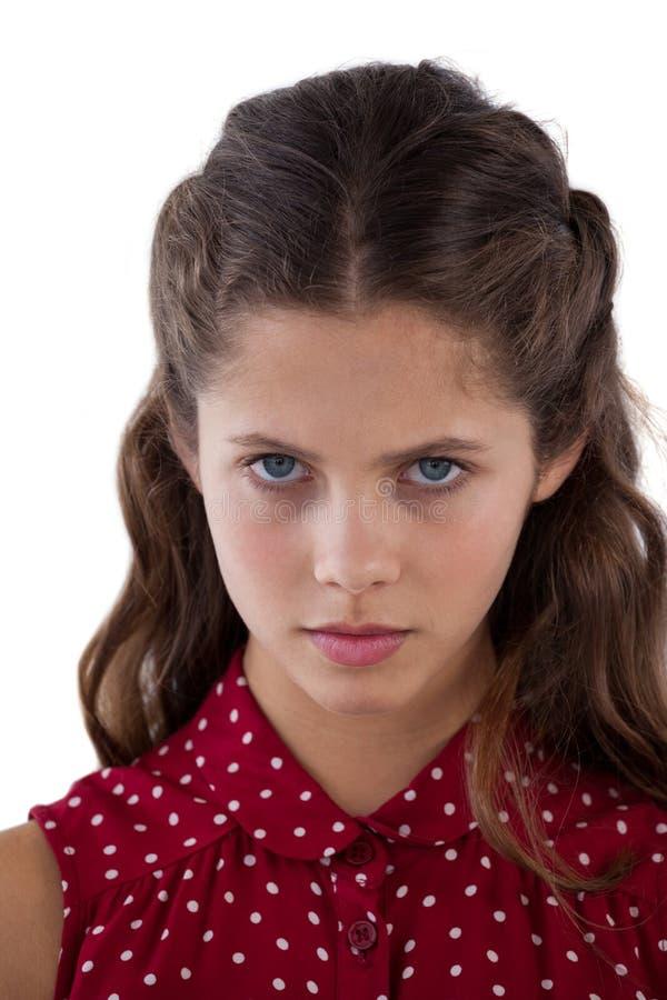 站立反对白色背景的十几岁的女孩 库存照片